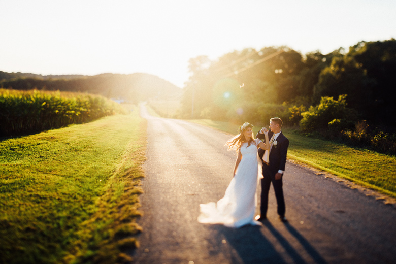 sugarland wedding sunset portrait of bride and groom on road