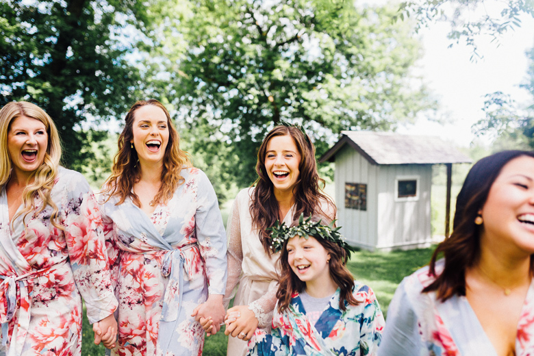 forest wedding bridesmaids in robes laughing