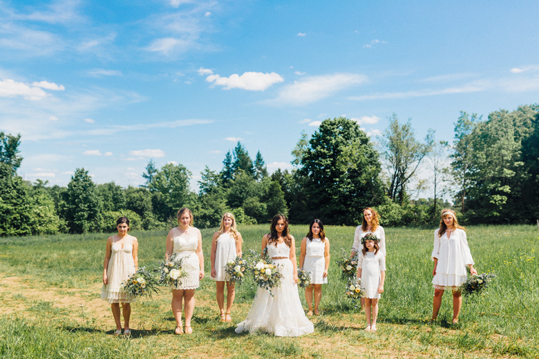 forest wedding bridesmaids in field