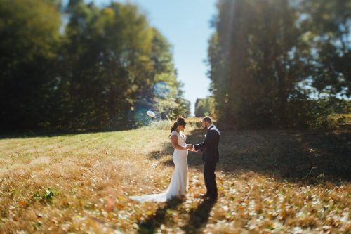 Blue Dress Barn Wedding First Look photographed by cling & peck